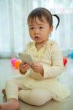 Portrait of pretty asian little girl talking Royalty Free Stock Photo