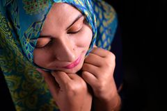 Portrait of pretty asian muslim woman in head scarf smile Royalty Free Stock Photo