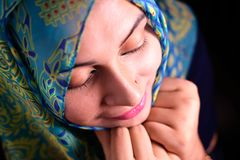 Portrait of pretty asian muslim woman in head scarf smile Stock Photos