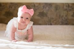 Portrait of pretty baby girl on bed , Family, childhood concept. copy space.  royalty free stock photo