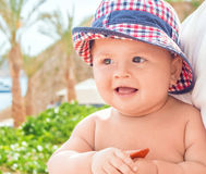 Portrait of a pretty baby with a hat stock photography