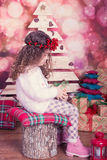 Portrait of pretty beautiful sweet little girl in Christmas interior Stock Photo
