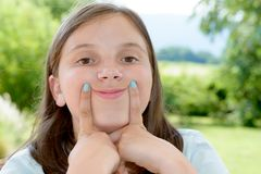 Portrait of pretty beautiful young girl making faces Royalty Free Stock Photo