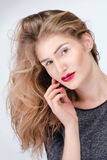 Portrait of a pretty blond girl with bright makeup Royalty Free Stock Images