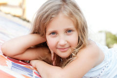 Portrait of a pretty blond  girl outside Stock Photography