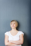 Portrait of a pretty blond woman on grey Royalty Free Stock Photography