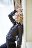Portrait of pretty blonde in black chiffon blouse Royalty Free Stock Images