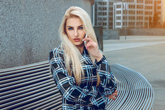 Portrait of pretty blonde business woman with blue eyes talking Royalty Free Stock Photo