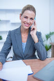 Portrait of a pretty blonde businesswoman phoning Royalty Free Stock Photo