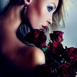 Portrait of pretty blonde  girl with flowers. Royalty Free Stock Images