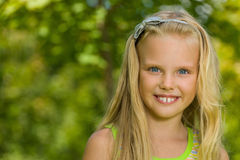 Portrait of a pretty blonde girl outdoors Royalty Free Stock Photos