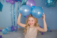 Portrait of Pretty blonde little girl with a color balloons. Over a head Royalty Free Stock Image