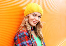 Portrait of pretty blonde woman in colorful clothes Royalty Free Stock Photo