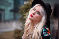 Portrait of pretty blonde woman with makeup outdoors Stock Photos