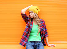 Portrait of pretty blonde woman posing in the city over colorful Stock Photo