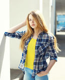 Portrait pretty blonde young girl wearing a checkered shirt Stock Images