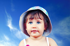 Portrait of pretty blue-eyed girl in a hat Royalty Free Stock Photography