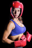 Portrait of pretty boxer with headgear and gloves Royalty Free Stock Image