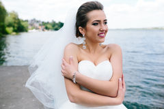 Portrait of pretty bride. Pictured in traditional white wedding dress stock photography