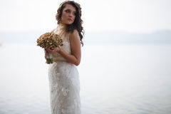 Portrait of pretty bride in white wedding dress. Stock Photography
