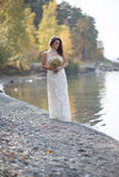 Portrait of pretty bride in white wedding dress. Royalty Free Stock Photography