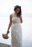 Portrait of pretty bride in white wedding dress. Royalty Free Stock Image