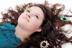 Portrait of pretty brunette girl with flowers Stock Photography