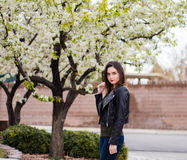 Portrait of pretty brunette girl outdoors. Outdoors portrait of a young attractive brunette woman Royalty Free Stock Images