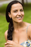 Portrait of a pretty brunette holding her braid Royalty Free Stock Photo