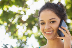 Portrait of pretty brunette woman being on the phone Royalty Free Stock Photo