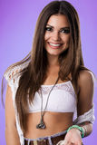 Portrait of pretty brunette woman looking at camera, posing and emotion smiling Wearing jean shorts, white crop top Royalty Free Stock Photos