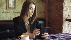 Portrait of pretty business lady using tablet in comfortable cafe 4k stock video footage