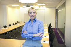 Portrait of pretty business woman in meeting room Royalty Free Stock Images