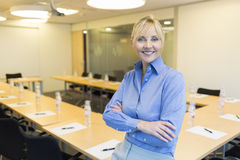 Portrait of pretty business woman in meeting room Stock Photos