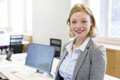 Portrait of pretty Businesswoman in modern office Royalty Free Stock Photo