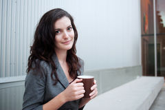 Portrait of a pretty businesswoman with mug Stock Photography