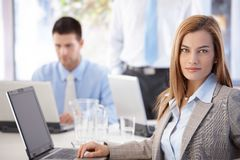 Portrait of pretty businesswoman sitting at desk Stock Photography