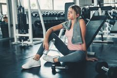 Portrait of Pretty Caucasian Woman is Exercised in Fitness Club, Attractive Woman is Resting After Working Out Jogging on royalty free stock photo