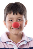 Portrait of a pretty child with a clown nose. Isolated on white Royalty Free Stock Photo