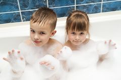 Portrait of pretty children little girl and boy in bath. Hygiene Royalty Free Stock Images