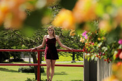 Portrait Pretty Colombian Girl Visiting Panama City As Tourist. Tourism in Panama City. Young blonde Colombian woman leaning on red rails, visiting Casco Antiguo Royalty Free Stock Image