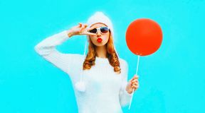 Portrait pretty cool girl blowing red lips sends an air kiss royalty free stock photography