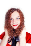 Portrait of pretty curly girl dressed as Santa Stock Images