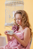 Portrait of pretty curly girl drinking tea Stock Photography