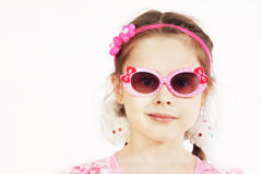 Portrait of a pretty cute young girl wearing pink sunglasses Stock Photography