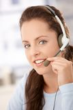 Portrait of pretty dispatcher with headphones Royalty Free Stock Photos