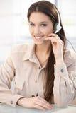 Portrait of pretty dispatcher smiling. Portrait of pretty young dispatcher with headset, smiling royalty free stock image