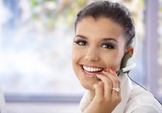 Portrait of pretty dispatcher smiling. Portrait of pretty young dispatcher, smiling, looking at camera Stock Photos