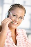 Portrait of pretty dispatcher working smiling. Portrait of pretty dispatcher working in office, using headset, smiling royalty free stock images