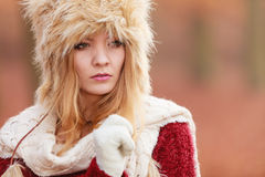 Portrait of pretty fashion woman in fur winter hat Stock Photography
